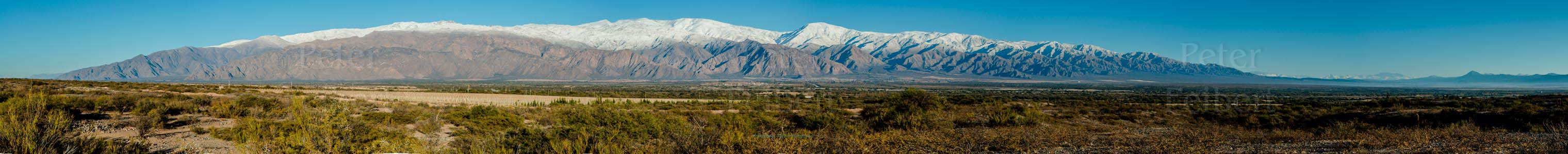 Snow in the mountains behind the town of Cafayate, Calchaquí valley, Salta, Argentina.
