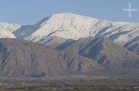 Snow in the mountains behind the town of Cafayate, Salta, Argentina